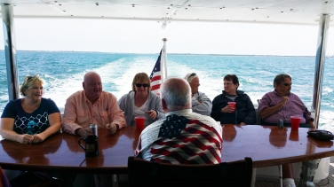 This one is a little overedited but it was so dark at the back of the boat. At least you can see everyone.